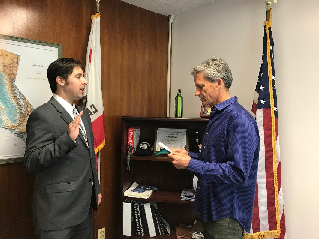 Ellis Raskin being sworn in by Redondo Beach Mayor Bill Brand